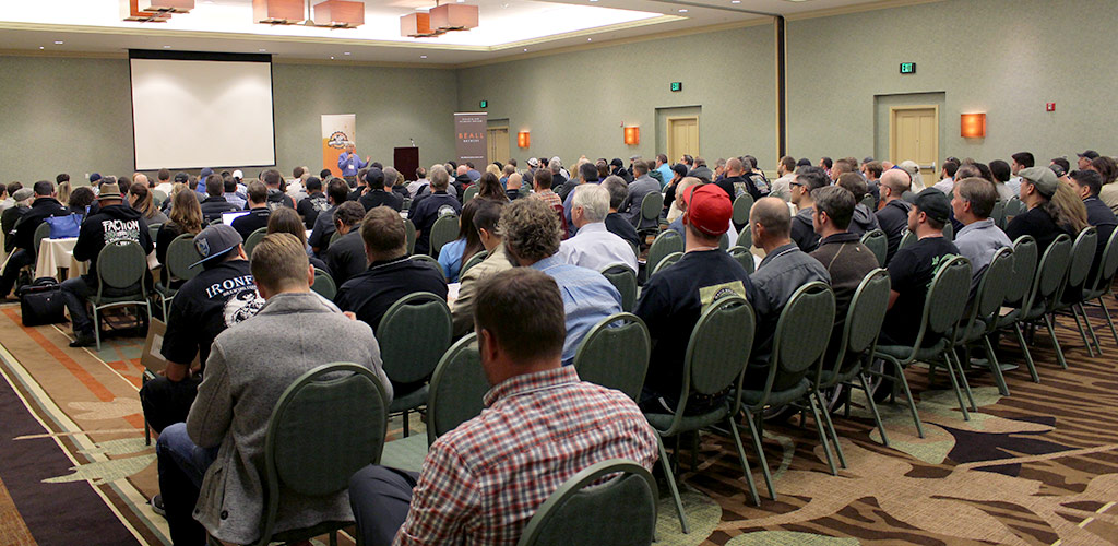 an image of the brewers conference inside a large room with lots of brewers and speakers